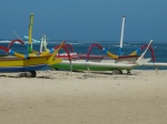 Day boats that you can rent in Sanur. Check out the faces painted on each one.