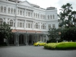 "raffles hotel, symbol of singapore's colonial past and britain's empire at large, houser of the dutch east india company, sprawling white hotel with fountains and turbined bellmen, origin of the ""singapore sling"""